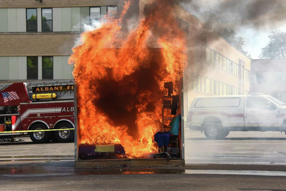 """Albany firefighters set fire to an dorm room """"pod"""" to show students at Albany College of Pharmacy how quickly a dorm room can become engulfed in flames on Friday, Aug. 23, 2019 in Albany, N.Y. (Lori Van Buren/Times Union)"""