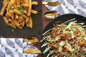 The menu includes spiced fries called Wolf Potato, upper left, and a shrimp yakisoba noodle dish at Blue Whale.