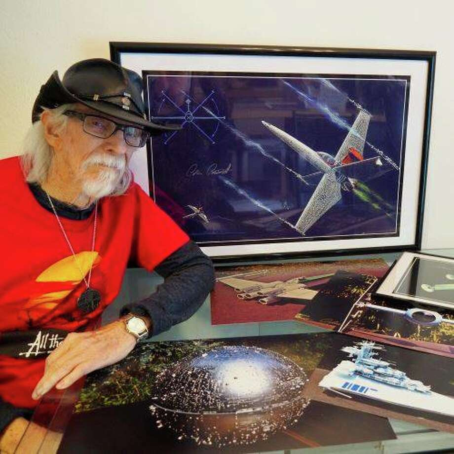 "Colin Cantwell poses next to concept art he drew of the ""X-Wing"" spaceship in the 1977 film ""Star Wars."" Photo: Photo Provided/Andrew Iwamasa"