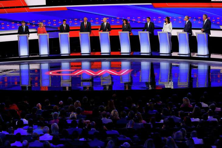Sen. Michael Bennet, D-Colo., from left, Sen. Kirsten Gillibrand, D-N.Y., former Housing and Urban Development Secretary Julian Castro, Sen. Cory Booker, D-N.J., former Vice President Joe Biden, Sen. Kamala Harris, D-Calif., Andrew Yang, Rep. Tulsi Gabbard, D-Hawaii, Washington Gov. Jay Inslee and New York City Mayor Bill de Blasio participate in the second of two Democratic presidential primary debates hosted by CNN, July 31, 2019, in the Fox Theatre in Detroit. (AP Photo/Paul Sancya)