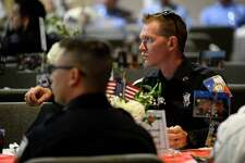 """A firefighter listens during the LIT Foundation's """"A Salute to the Real American Heroes"""" dinner at Wesley United Methodist Church. The event is a fundraiser for scholarships for students in fire, EMS, police, criminal justice and homeland security programs. Photo taken Thursday 9/6/18 Ryan Pelham/The Enterprise"""