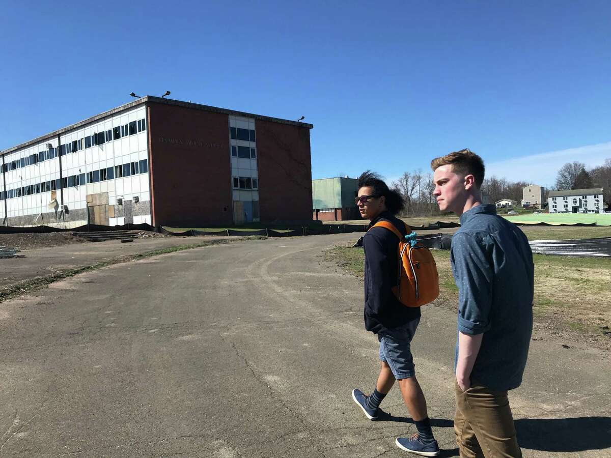 University of Connecticut students Robin Rittgers, left, and Matt McKenna, right, who are part of the CT Brownfields Initiative Programcohorttouring brownfield sites in Newhallville. The programs has students and faculty at the university assist municipalities with brownfield revitalization work.