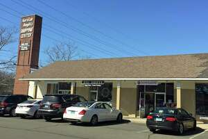 The Noroton Heights Shopping Center will be razed this fall and redeveloped with two three-story buildings and first-floor retail, complete with a public plaza.