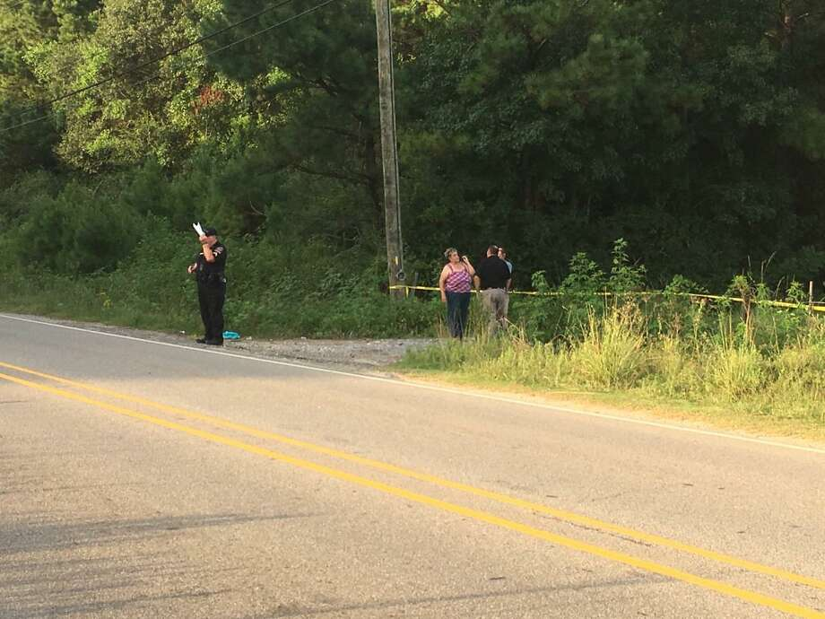 Vidor police investigate at the scene where a body was located Tuesday. Photo: Photo Provided By Eric Williams