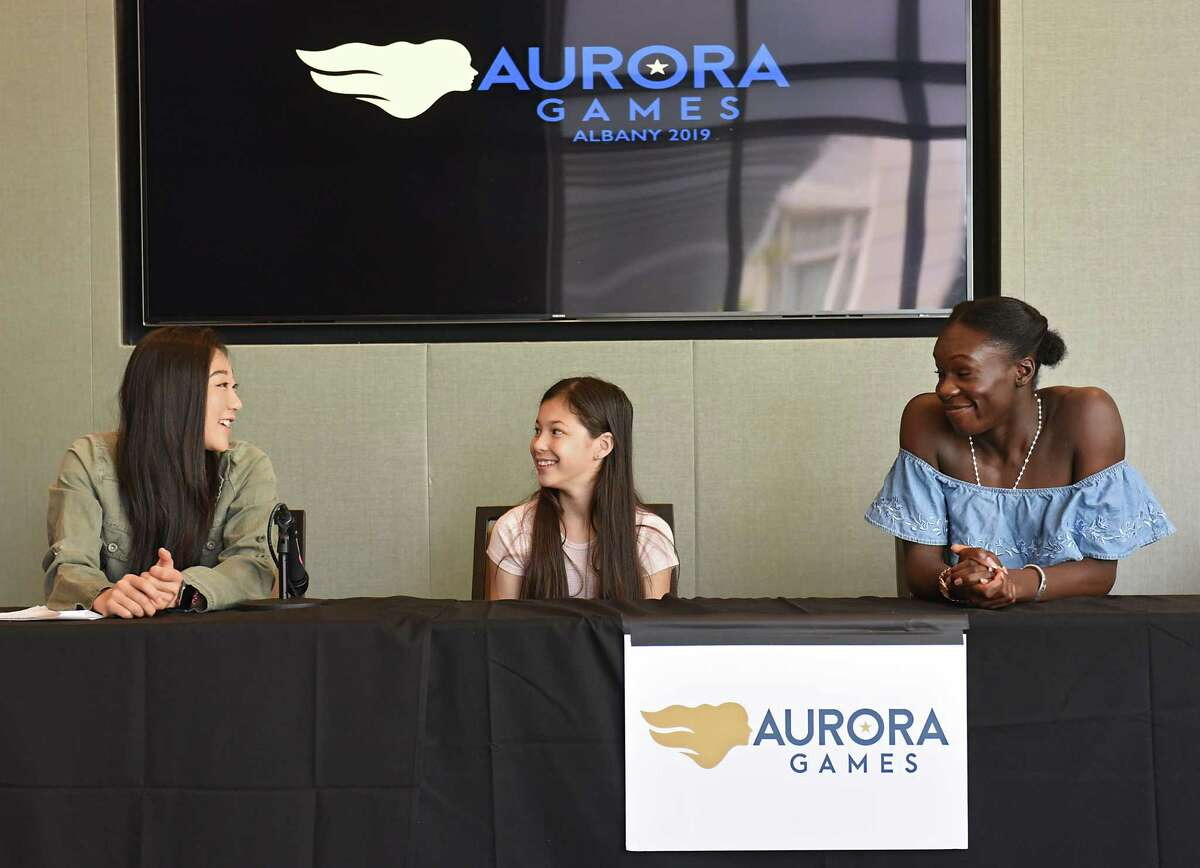 Figure skaters, from left, Mirai Nagasu (U.S), Alysa Liu (U.S.) and MaA½-BA½rA½nice MA½itA½ (France) answer questions during the Aurora Games daily press conference at the Albany Capital Center on Friday, Aug. 23, 2019 in Albany, N.Y. (Lori Van Buren/Times Union)
