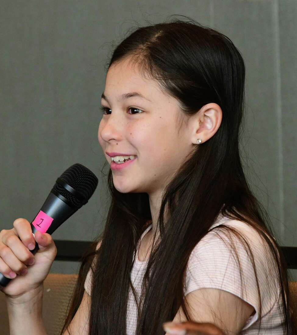 Figure skater Alysa Liu (U.S.) answers questions during the Aurora Games daily press conference at the Albany Capital Center on Friday, Aug. 23, 2019 in Albany, N.Y. (Lori Van Buren/Times Union)