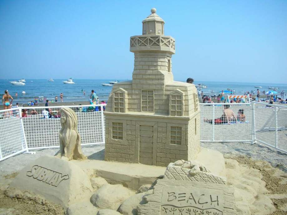 This sand sculpture, depicting the Penfield Lighthouse, was fashioned at the first Sand Sculpture Festival at Penfield Beach. This year's event, organized by the Fairfield Beach Residents Association and the Inn at Fairfield Beach, runs from Thursday through Sunday. Photo: Contributed Photo / Fairfield Citizen