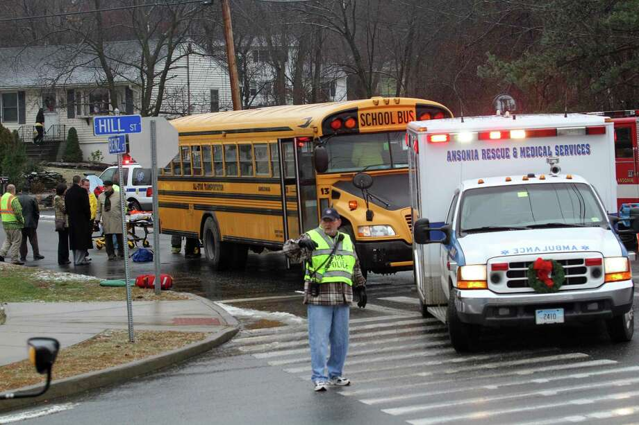 FILE PHOTO: Several Ansonia High School students and their bus driver were taken to Griffin Hospital for precautionary reasons after their bus was rear ended on Benz Street near Hill Street in Ansonia on back in December 2013. Police issued some back-to-school tips to in an effort to ensure incidents like this don't happen again. Photo: Hearst Connecticut Media File Photo / Connecticut Post freelance B.K. Angeletti