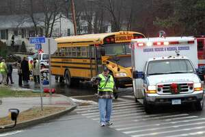 FILE PHOTO: Several Ansonia High School students and their bus driver were taken to Griffin Hospital for precautionary reasons after their bus was rear ended on Benz Street near Hill Street in Ansonia on back in December 2013. Police issued some back-to-school tips to in an effort to ensure incidents like this don't happen again.