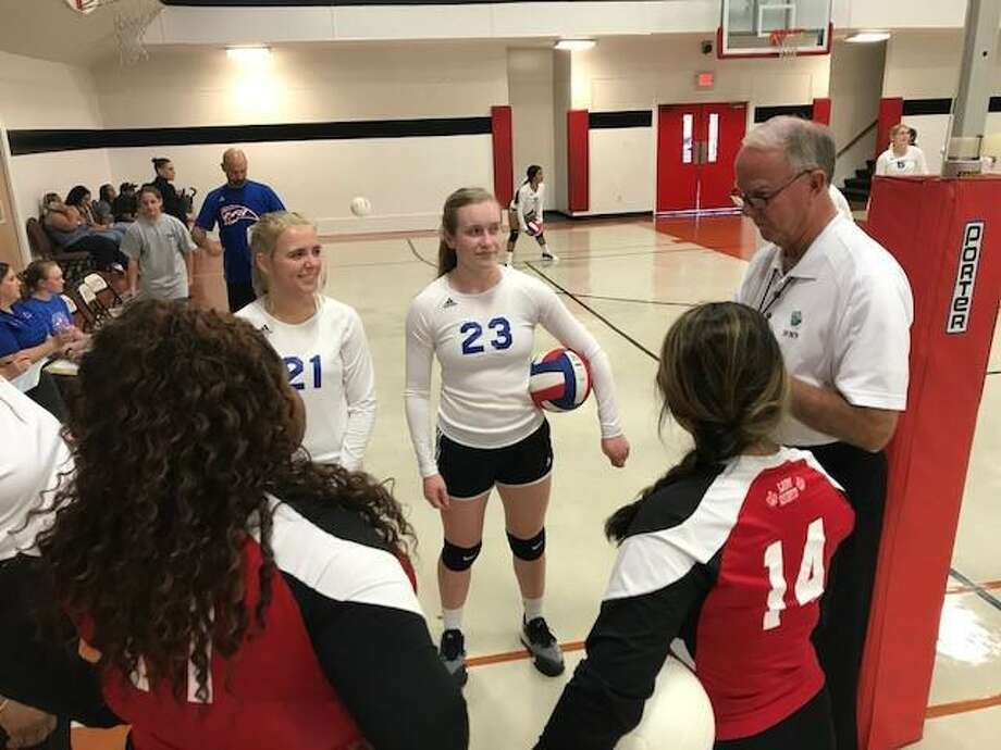 Bob Ellis, the city's athletic director, stepped aside from that job Thursday night to help officiate the Faith Christian-First Baptist Christian Academy match. He gets ready to conduct the coin flip as FCA;s Angela McDuff (14) and Tyanna Thompson plus FBCA's Sarah Bailey (21) and Jenna Patteson look on. Photo: Robert Avery