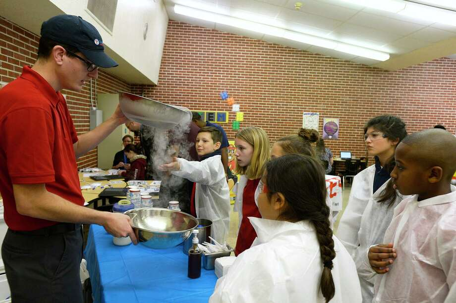 Ray Hawk, general manager of SubZero Ice Cream, shows students how they use liquid nitrogen to make ice cream at an open house for Beaumont ISD's new STEM Center at the former Austin Middle School on Thursday afternoon. The center will serve as a lab for students from the district to learn about science, technology, engineering and math fields.  Photo taken Thursday 1/25/18 Ryan Pelham/The Enterprise Photo: Ryan Pelham / Ryan Pelham/The Enterprise / ©2017 The Beaumont Enterprise/Ryan Pelham