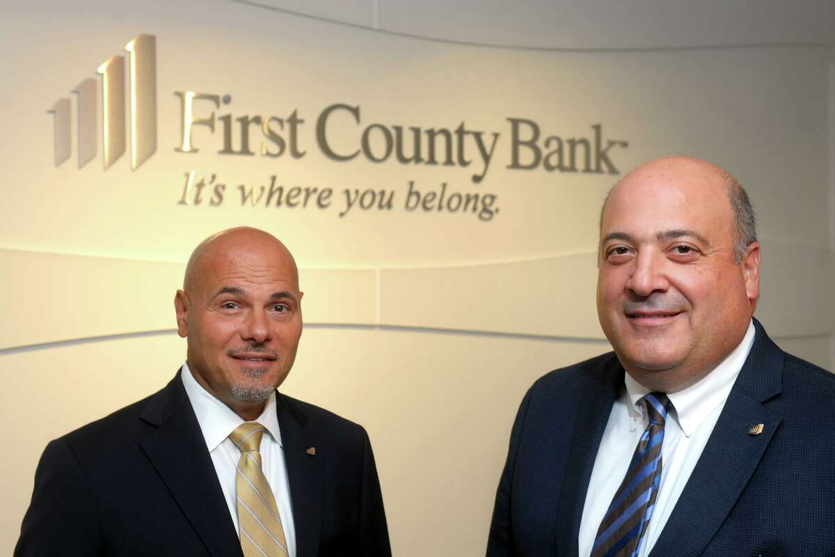 Robert Granata, right, Chairman and Chief Executive Officer of First County Bank, and Willard Miley, the bank's President and Chief Operating Officer pose in the bank's headquarters in Stamford, Conn. Aug. 21, 2019.