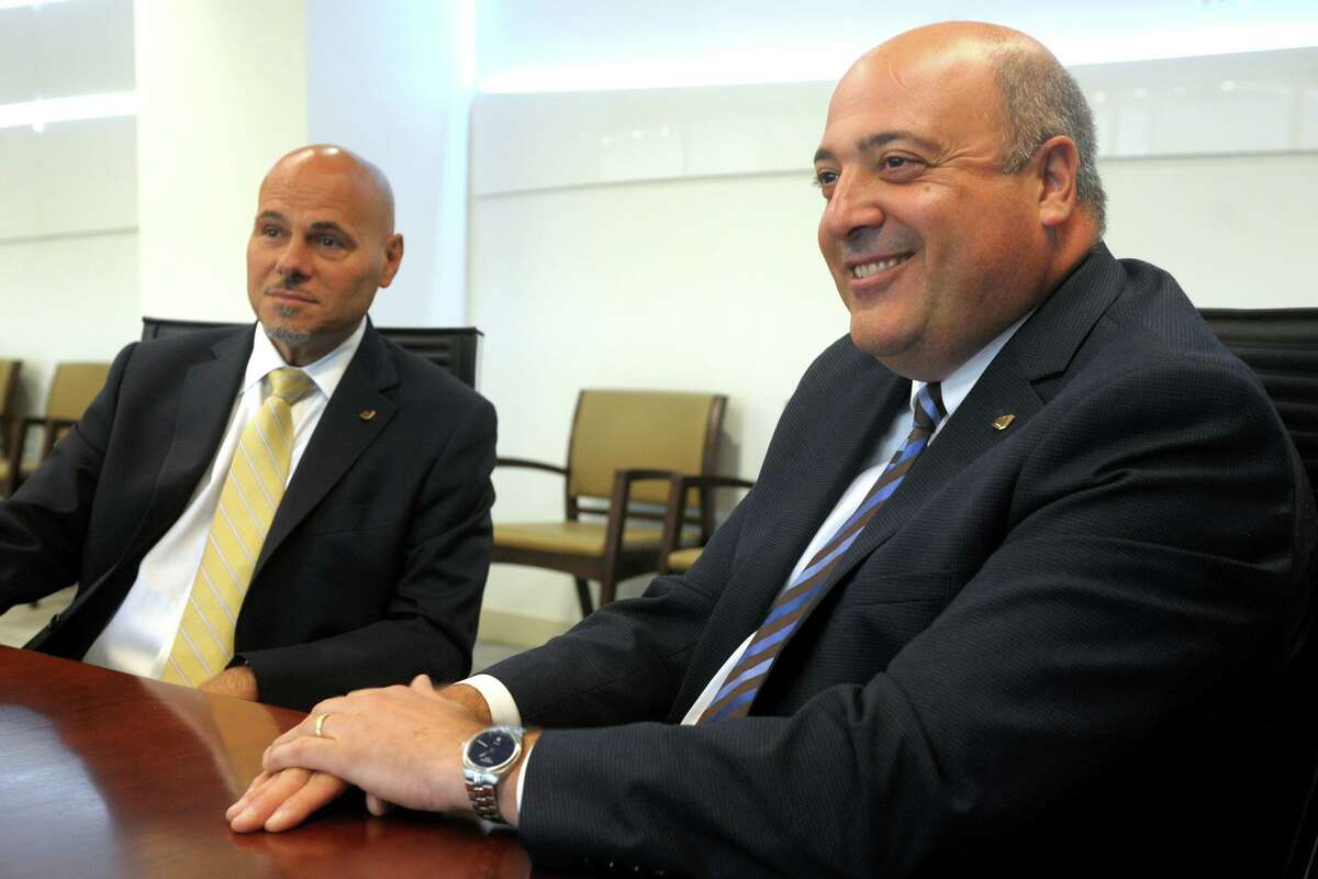 Robert Granata, right, Chairman and Chief Executive Officer of First County Bank speaks during an interview in the bank's headquarters in Stamford, Conn. Aug. 21, 2019. Granata is seen here with Willard Miley, the bank's President and Chief Operating Officer.