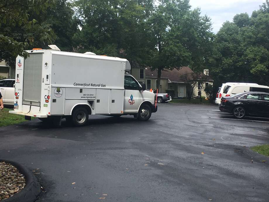 Work crews from Connecticut Natural Gas restore service at Greenwich Oaks off Weaver Street Friday morning. Photo: / Robert Marchant / Hearst Media