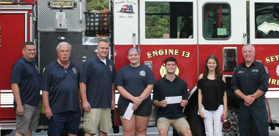 From left, Jon Rollinson, Randy Lewis, Citizens President Mike Russell, Taylnn Christiani, Andrew Miller, Taylor Dauphinais and Lt. John Hannon. Missing from photo is Zachary Saracino. Photo: Citizens Engine Co. No. 2