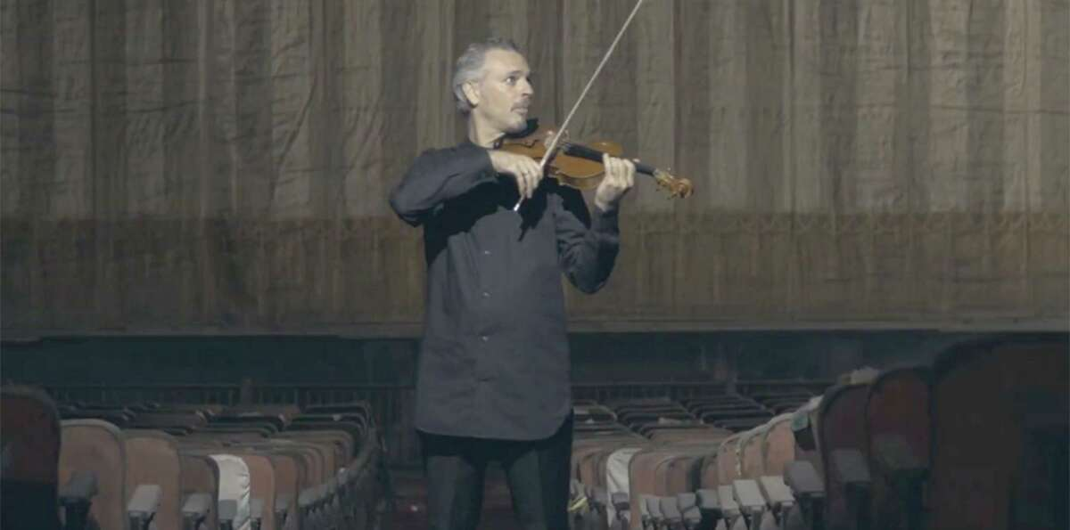 """The Greater Bridgeport Symphony, with Eric Jacobsen, music director, and Colin Jacobsen, violinist, perform Ralph Vaughan Williams' """"The Lark Ascending"""" in the Palace Theater in Bridgeport."""