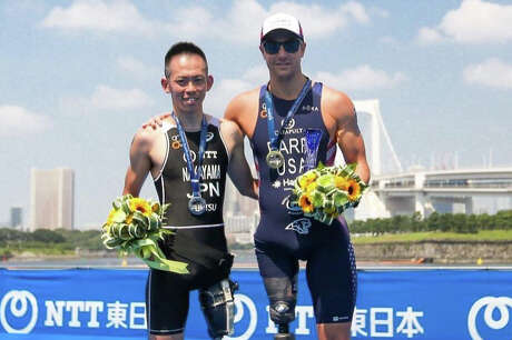 Mark Barr (right) beat out Japan's Kenshiro Nakayama to win the recent Tokyo Paralympic Test event after dealing with adversity that included missing equipment and having to compete in a different event.