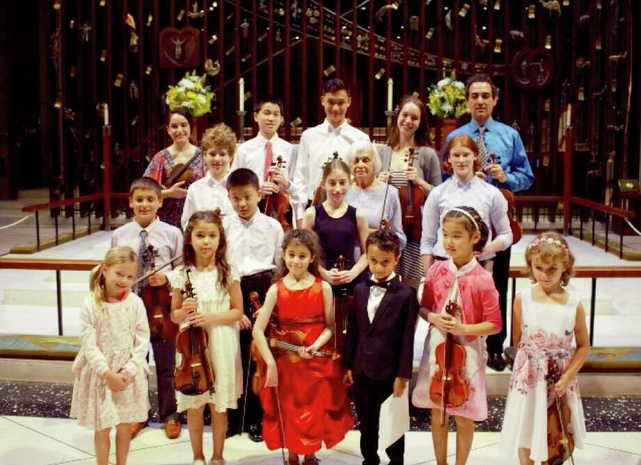Yaroslav Kargin hosted his annual recital earlier this summer. In front are Jones Glenn, Arianna Angarita, Eden Levy Roginsky, Maxim Jayaweera, Arila Liu and Lucia Coppola. In the second row are Martin Novak, Nathan Dai and Alessandra Gavriloiu. In the third row are Brendan Kaduboski, Gertrude Goldberg and Vaughn Slatoff. In back are Elena Brennan, Brandon Bao; Jordan Song, Sofia Pronina and Kargin. Photo: Contributed Photo / New Canaan Advertiser Contributed