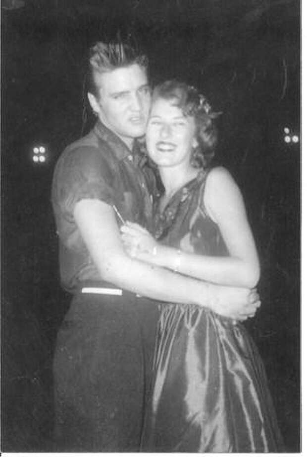 Local radio personality Mary McCoy, right, with the one and only Elvis when he was in Conroe as a part of the Louisiana Hayride Tour on Aug. 24, 1955. McCoy was a teenager at the time and still continues her radio career on KSTAR today. / Internal