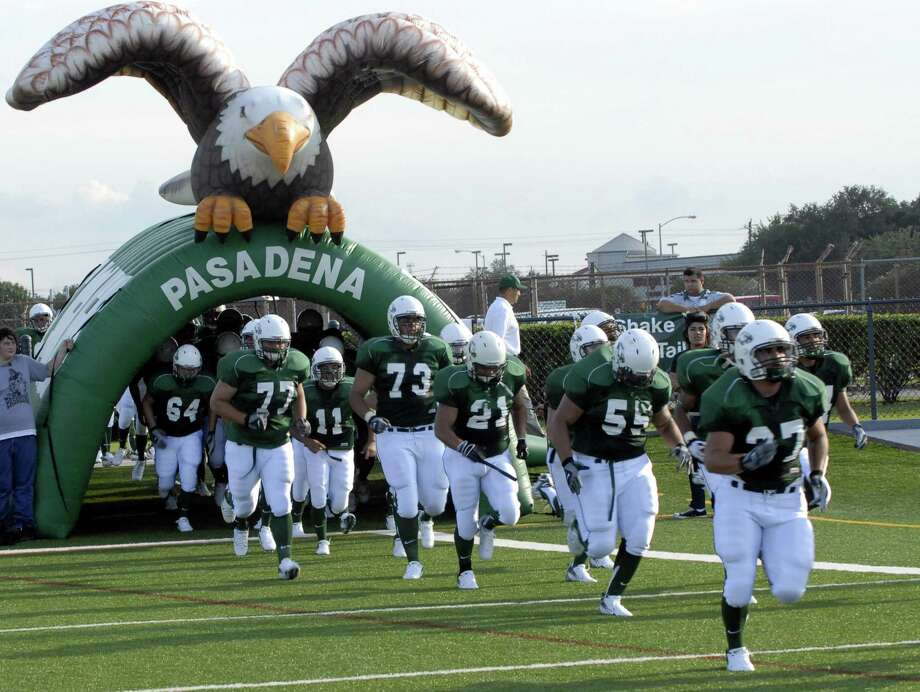 The Pasadena High eagle mascot, hovering over the school's football players in this 2008 photo, is associated with generations of tradition. Students and alumni at high schools in Pasadena ISD cherish their mascots. Photo: Kim Christensen, Freelance / For The Chronicle / Freelance