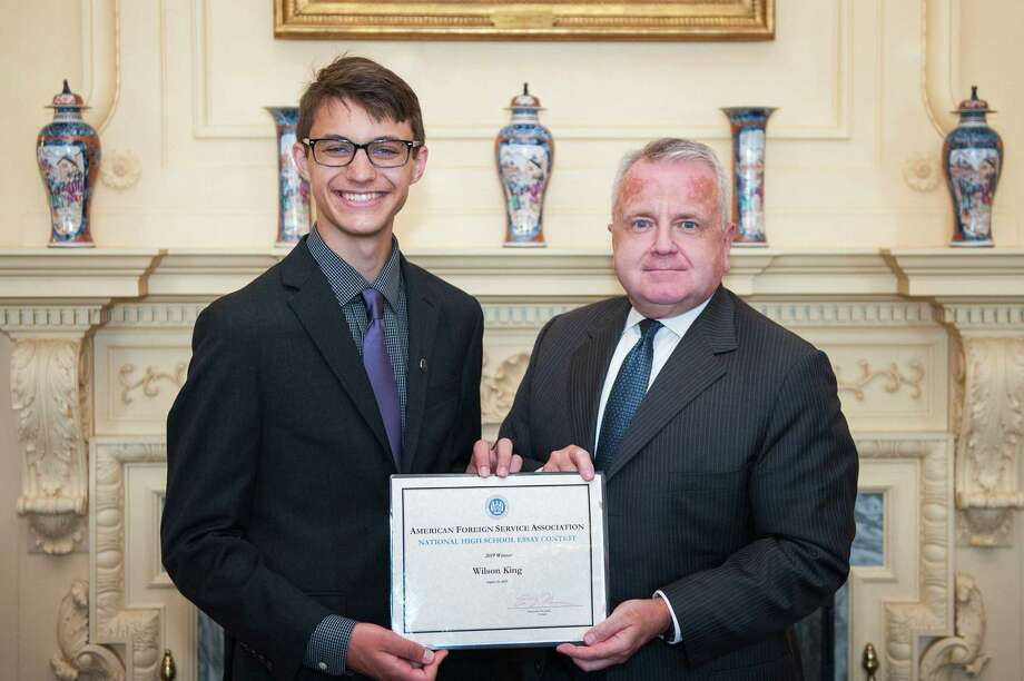 "Wilson King was recognized by U.S. foreign officials in Washington D.C. for his winning essay ""From Dictatorship to Democracy: The Power of Cooperation in Military Interventions."" Photo: Director General Of The Foreign Service & Director Of Human Resources At The U.S. State Department's Twitter"