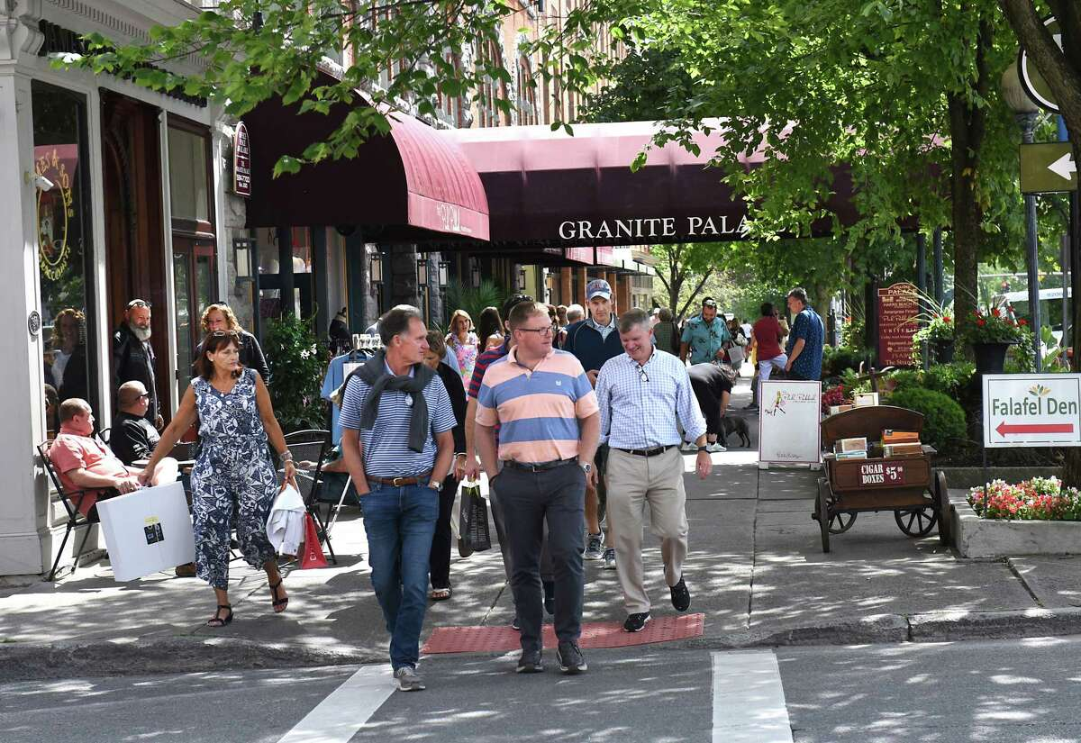 Broadway is bustling a day before Travers day on Friday, Aug. 23, 2019 in Saratoga Springs, N.Y. (Lori Van Buren/Times Union)