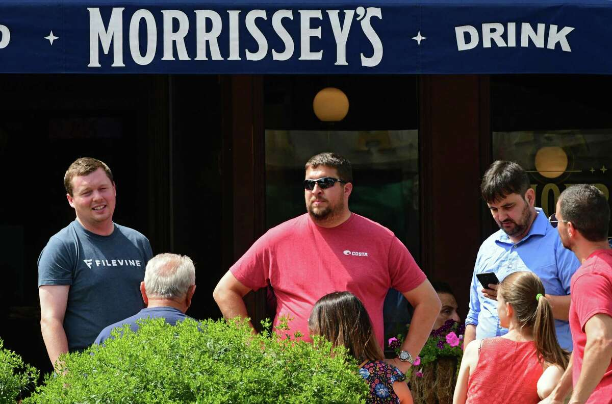 A group waits outside of Morrissey's a day before Travers day on Friday, Aug. 23, 2019 in Saratoga Springs, N.Y. (Lori Van Buren/Times Union)
