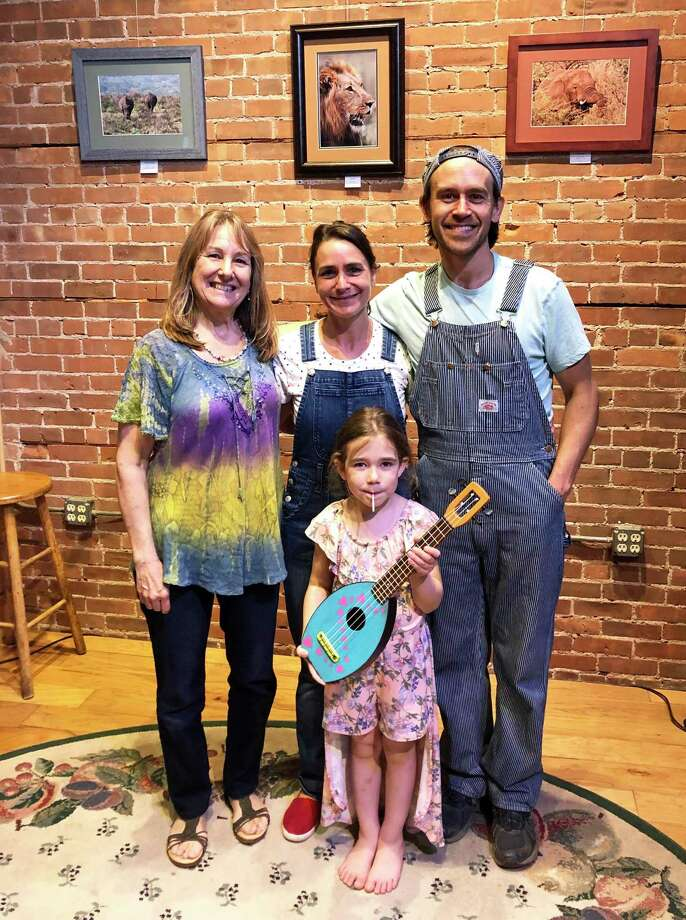 From left are Anne-Marie Cannata McEwen and members of the Sunny Train band, Anastasia and Christopher Jankowski. At front is Cannata McEwen's granddaughter Indi. They're shown at The Buttonwood Tree on Main Street. Photo: Contributed Photo