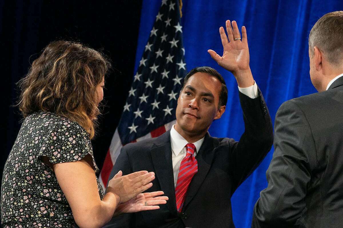(Center) Secretary Juli�n Castro waves while walking on stage at the Democratic National Committee (DNC) Summer Meeting at the Hilton Union Square Hotel in San Francisco, Calif., on Friday, August 23, 2019.