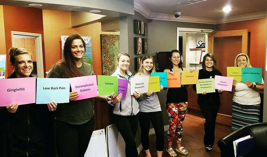 Staff members at Foley Dental in Maryville pose during Mental Health First Aid training. The group illustrates how disabling mental issues can be yet is a topic that isn't always discussed. Photo: For The Intelligencer