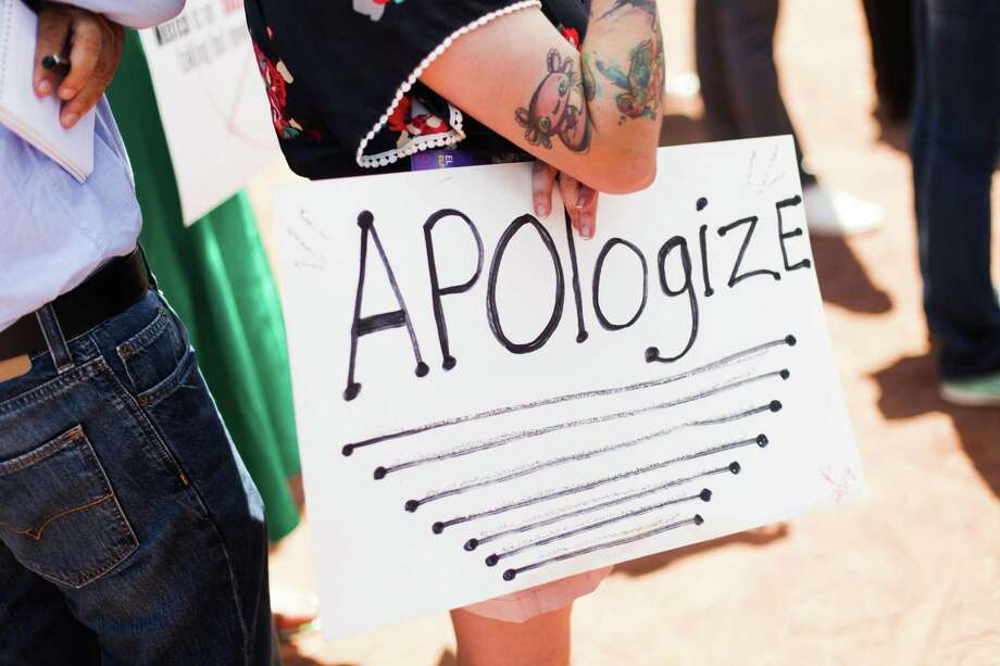 A protester opposed to President Donald Trump's visit to El Paso holds a sign at a rally earlier this month. Racial tensions have been on the rise during the Trump administration, and with that comes distrust. Photo: Celia Talbot Tobin /New York Times / NYTNS