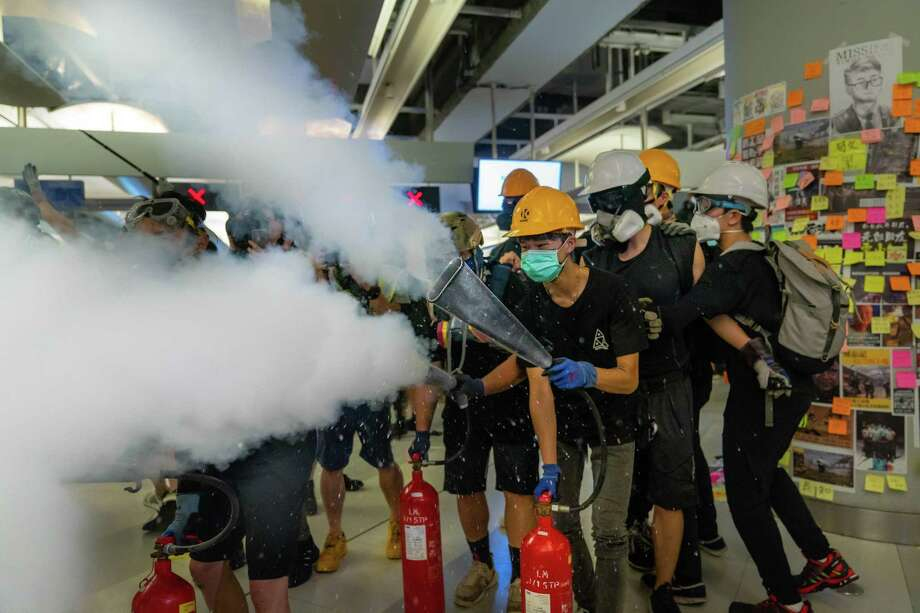 Protestors spray fire extinguishers during a protest Wednesday in Hong Kong. A reader recalls a trip to China in the '90s, where he sensed tensions were already high. Photo: Billy H.C. Kwok /Getty Images / 2019 Getty Images