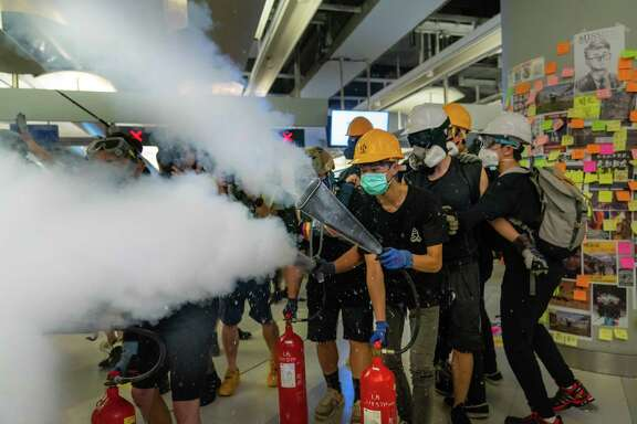 Protestors spray fire extinguishers during a protest Wednesday in Hong Kong. A reader recalls a trip to China in the '90s, where he sensed tensions were already high.