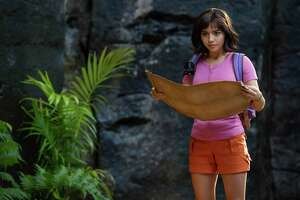 "Dora (Isabela Moner) cosults the map in ""Dora and the Lost City of Gold."""
