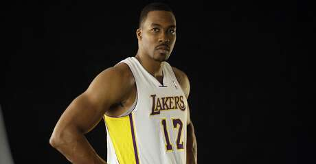 Los Angeles Lakers center Dwight Howard at the NBA basbetball team's media day at team headquarters in El Segundo, Calif., Monday, Oct. 1, 2012. (AP Photo/Reed Saxon)