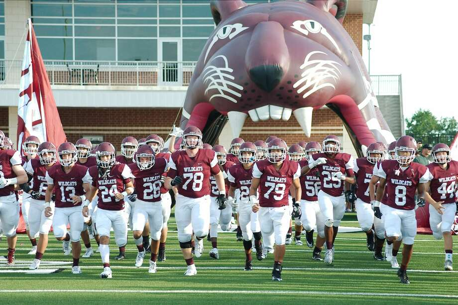 Clear Creek Wildcats. A massive wildcat with gaping jaws looms over the Clear Creek High School football team as it takes the field at Challenger Memorial Stadium. Photo: Kirk Sides/Staff Photographer
