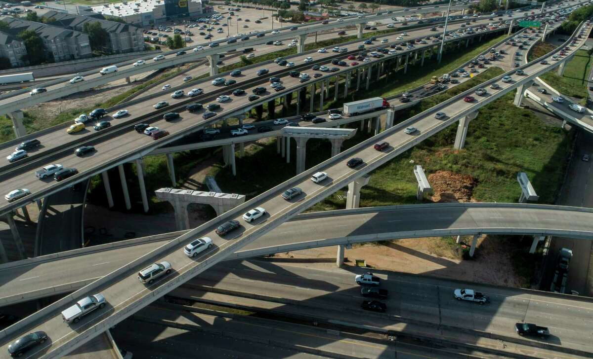 Houston motorists travel on Interstate 69 and Loop 610 through Uptown on Aug. 21, 2019, in Houston.