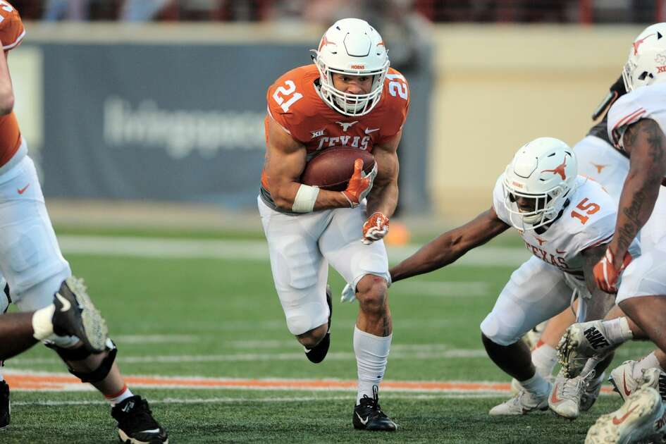 AUSTIN, TX - APRIL 13: Freshman RB Jordan Whittington (21) runs for yardage during the Longhorns spring game on April 13, 2019, at Darrell K Royal-Texas Memorial Stadium in Austin, Texas. (Photo by John Rivera/Icon Sportswire via Getty Images)