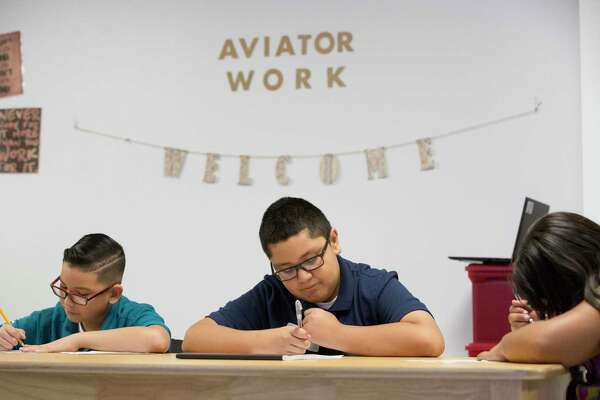 In this August photo, YES Prep Hobby inaugural sixth-graders Jaciel Maldonado, from left, Angel Lopez and Amy Lopez work on their worksheets in a class on orientation day. YES Prep ranked received a B grade under the state's academic accountability system in 2019.