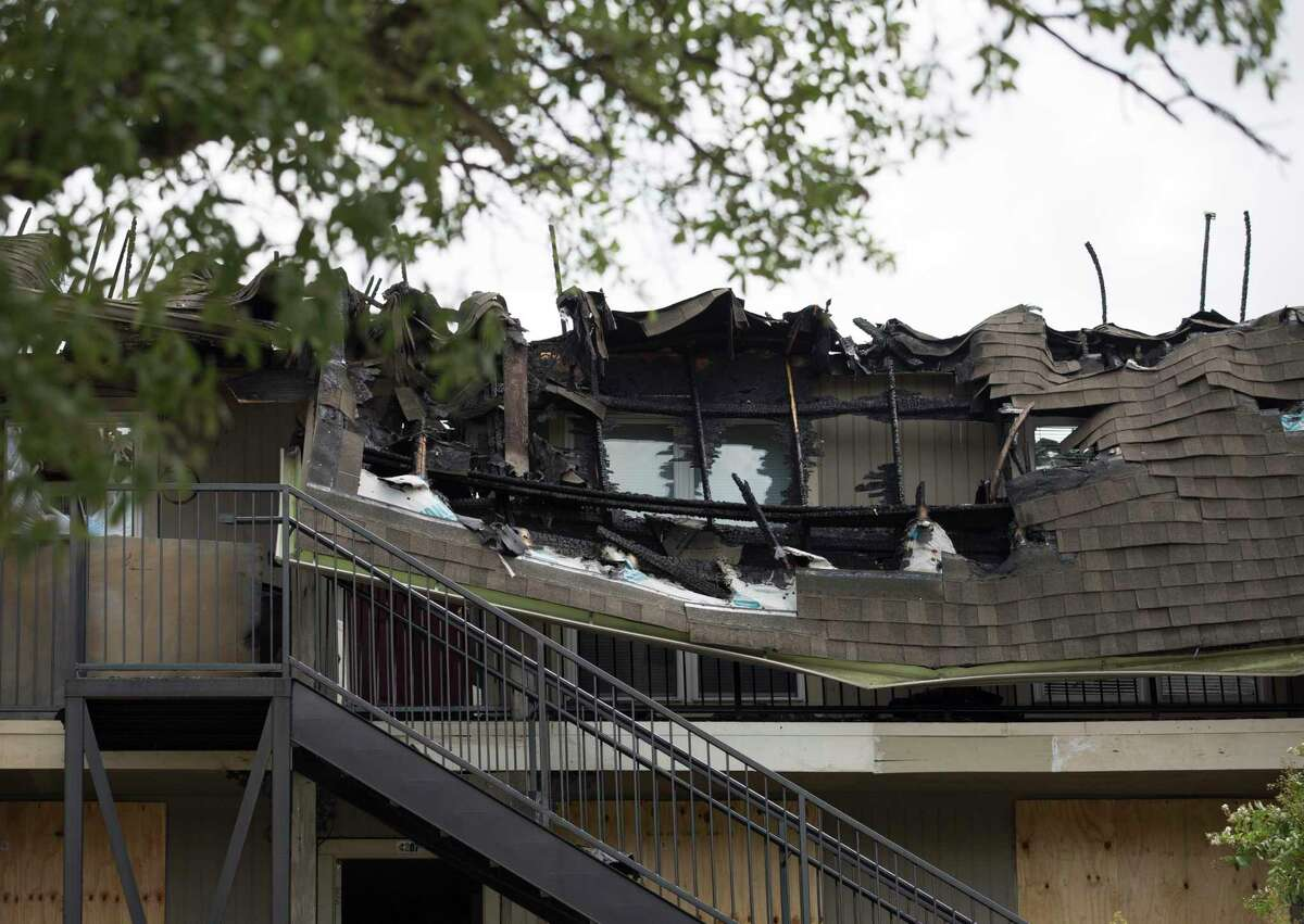 Roofs collapsed at Lisa Jenkins's third-floor apartment at the Haverstock Hills Apartments, located at the 5600 block of Aldine Bender Road, after an overnight fire that burnt down the third floor of the three-story building on Friday, Aug. 23, 2019, in Houston. The two-alarm fire started before 1 a.m. at the apartment complex located at the 5600 block of Aldine Bender Road, and 27 people were displaced. Jenkins lost everything in her third-floor apartment, and didn't know where she could stay.