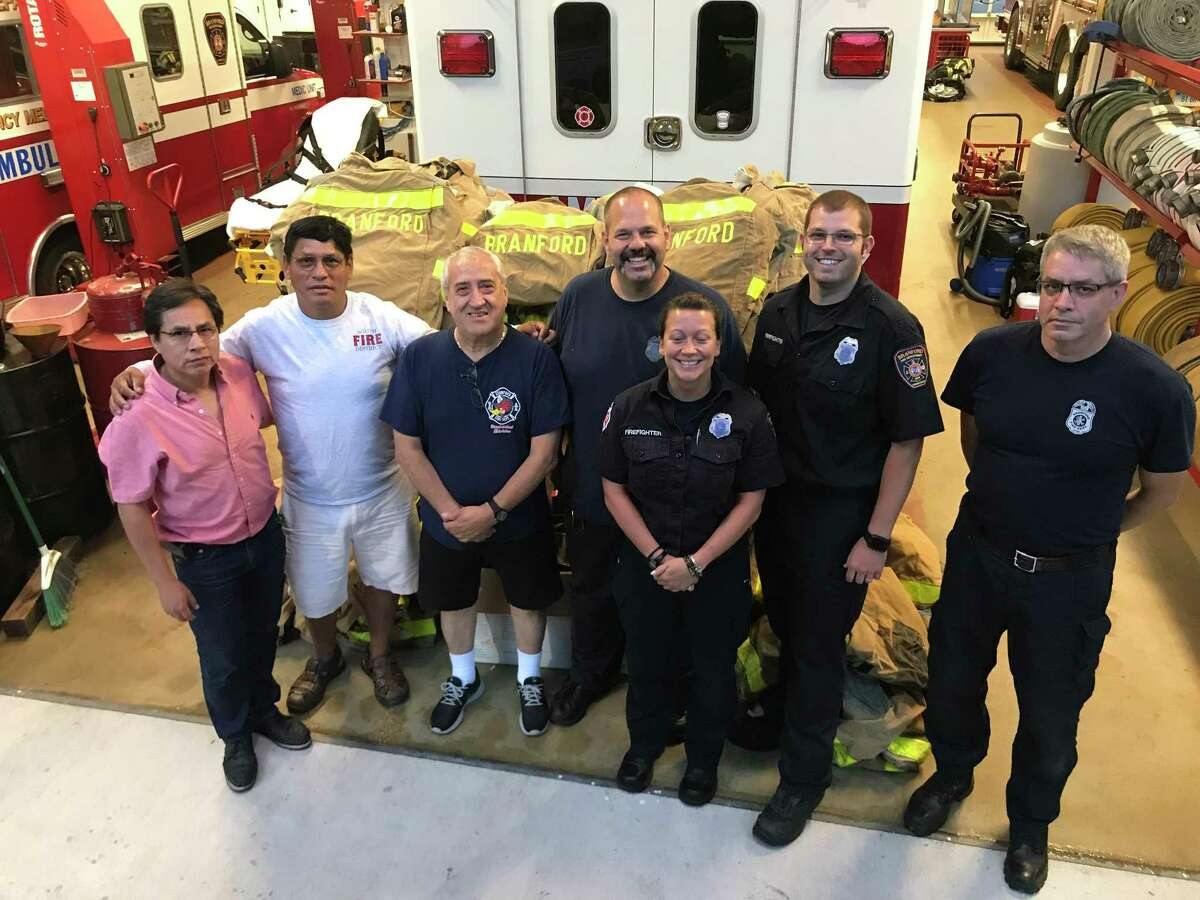 Members of the Lima, Peru fire department recently came up to meet some of their counterparts and help load equipment being donated by 14 Connecticut fire departments in an effort organized by the Stamford Fire Department and the Stamford-based Peruvian American Community Center of Connecticut. Here, two representatives from Lima, who were not immediately identified, join Willy Giraldo, third from left, a member of Stamford's Board of Representatives who works with the Peruvian Community Center, and Branford firefightersJoe Laudacina, MacKenzieSpooner, Garret Lizze and Rick Hart.