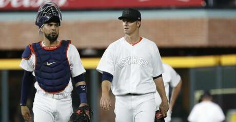 Houston Astros starting pitcher Zack Greinke (21) walks out of the bullpen with catcher Robinson Chirinos (28) before the start of the first inning of an MLB game at Minute Maid Park, Friday, August 23, 2019.