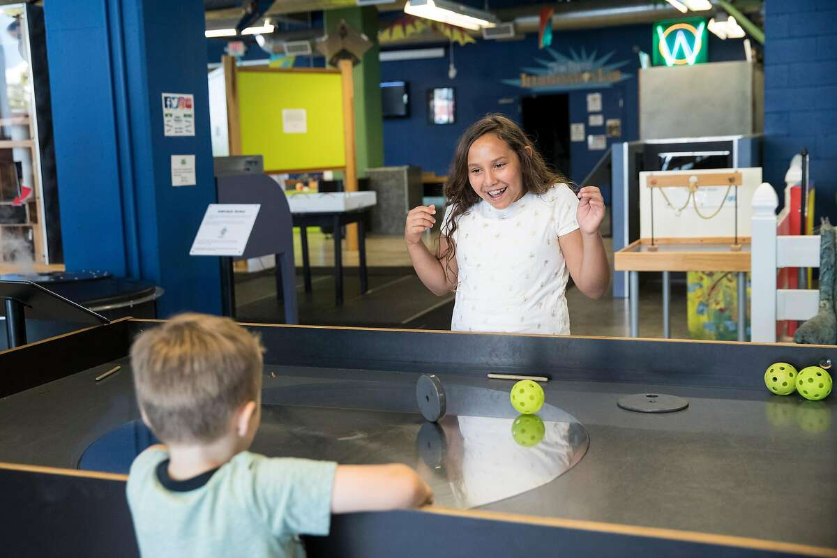 Raquel Esquivel, age 9, and Ryan Pachoud, age 5, play at the turntable exhibit at the World of Wonders museum in Lodi, Calif., on Saturday, August 17, 2019. The hands-on and interactive educational science museum is located in downtown Lodi.