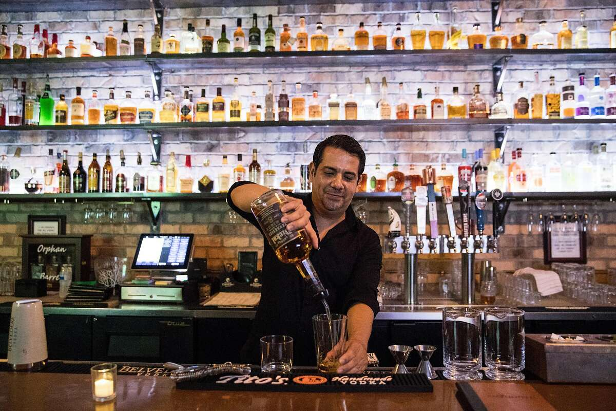 Bar Manager Michael Olivas works at 20 North in downtown Lodi, Calif., on Friday, August 16, 2019. The bar offers over 300 spirits from an array of signature cocktails to craft beers.