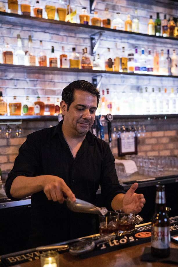 Bar Manager Michael Olivas works at 20 North in downtown Lodi. The bar offers over 300 spirits from an array of signature cocktails to craft beers. Photo: Laura Morton