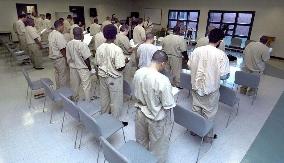 Inmates at Garner Correctional in Newtown gather on the second Thursday of the month for a Praise, Worship and Bible Study conducted by the Prison Ministry of House of Grace Ministries. Photo taken April 24, 2008 by Carol Kaliff Photo: Carol Kaliff / Hearst Connecticut Media / The News-Times