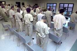 Inmates at Garner Correctional in Newtown gather on the second Thursday of the month for a Praise, Worship and Bible Study conducted by the Prison Ministry of House of Grace Ministries. Photo taken April 24, 2008 by Carol Kaliff