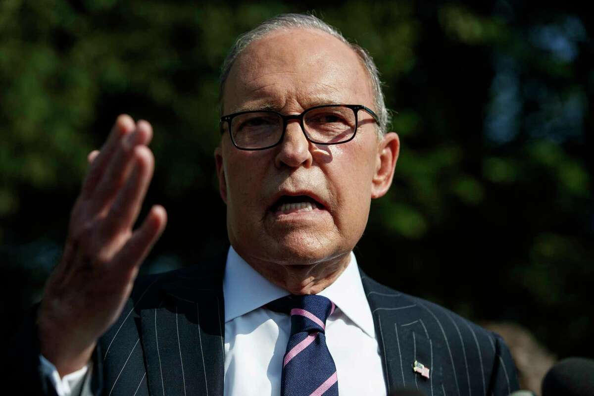 FILE - In this Aug. 6, 2019, file photo, White House chief economic adviser Larry Kudlow talks with reporters outside the White House in Washington. Where past presidents have relied on top academics, business leaders and officials with experience in prior administrations, Trump has gone a different route. Hea€™s built crew of camera-ready economic advisers, rather than one known for its policy chops. (AP Photo/Evan Vucci, File)