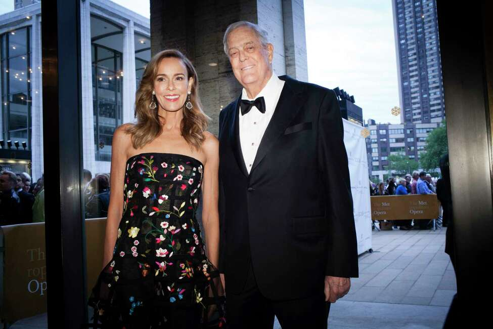 FILE -- David Koch and his wife, Julia, at Lincoln Center in New York on May 18, 2015. Koch, who joined his brother, Charles Koch, in business and political ventures that grew into the nationa€™s second-largest private company and a powerful right-wing libertarian movement that helped reshape American politics, has died, his brother Charles announced on Friday, Aug. 23, 2019. He was 79. (Deidre Schoo/The New York Times)