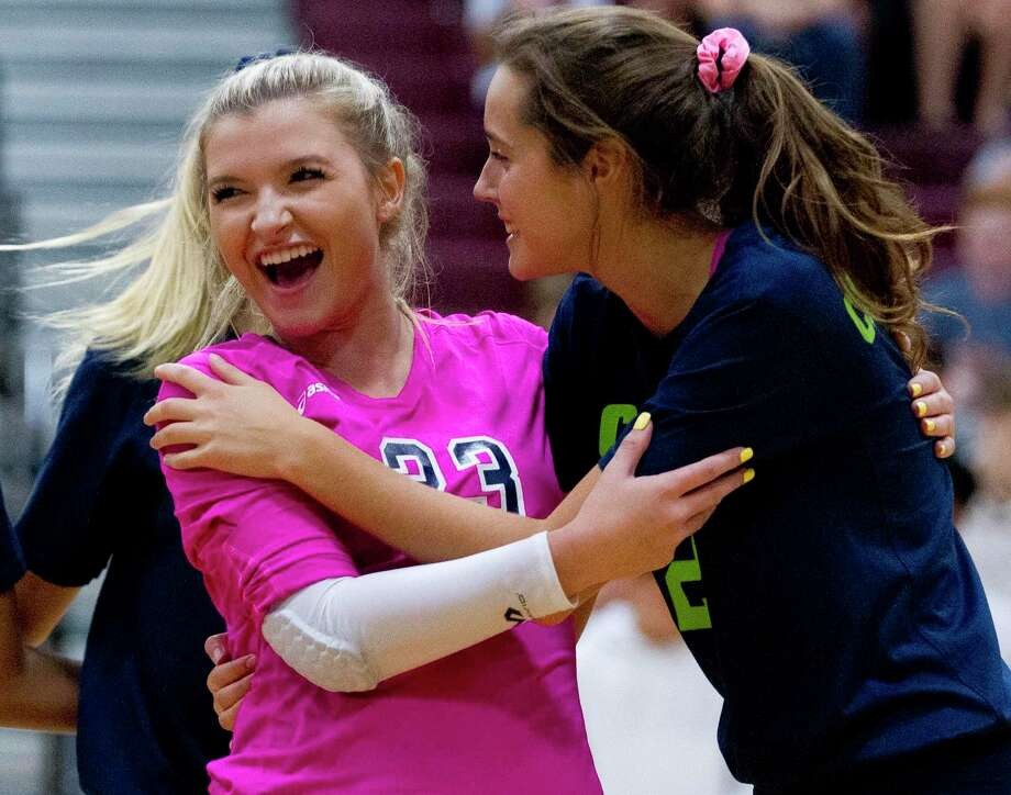 College Park outside hitter Noelle Palmer (2) gets a hug by libero Caley Caffey after an ace in the second set of a non-district high school volleyball match, Friday, Aug. 23, 2019, in Magnolia. Photo: Jason Fochtman, Houston Chronicle / Staff Photographer / Houston Chronicle